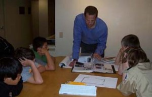 Mike Ullrich, architect at Pagenstecher Group based in Kensington, Md., shows a fifth-grade Boy Scouts group how to read design plans and apply them to the construction process.