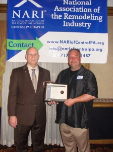 NARI past president Michael Hydeck, MCR, CKBR presents NARI Central PA chapter president Joseph Sullenberger with a new chapter charter at the first Meet & Mingle meeting on April 18, 2013.