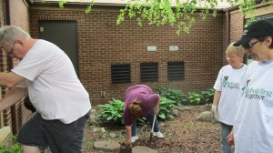NARI Director of Education, Dan Taddei digs a hole as Executive Vice President, Mary Harris and Adminstrative Assistant, Judy Carlsen look on.
