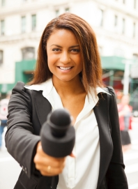 Female Reporter with Microphone